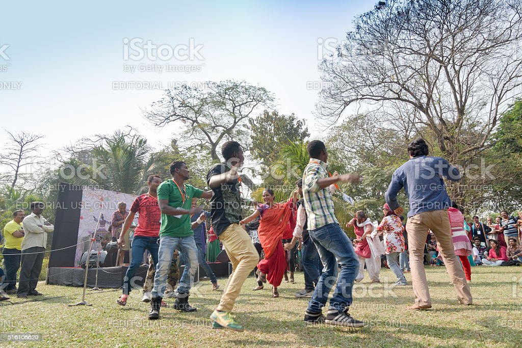 Young crowd from different cultures, dancing in Sufi Sutra festival stock photo