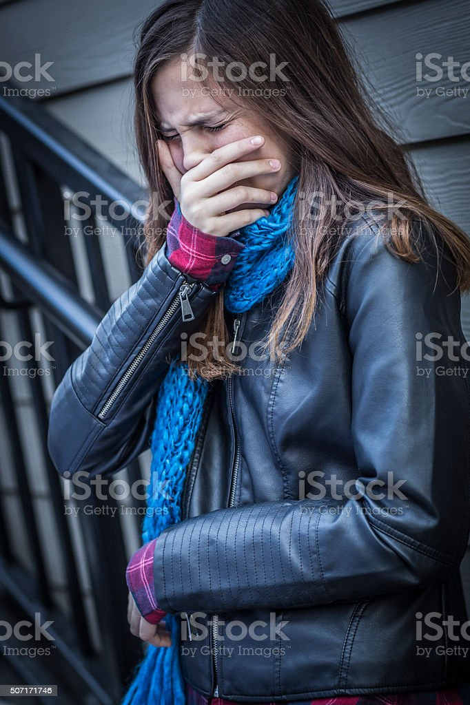 Young Crying Teen Aged Girl on Staircase stock photo