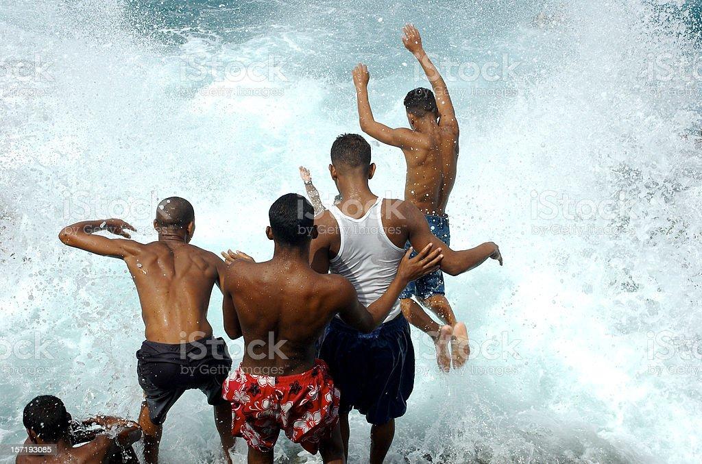 Young Cuban Men Jump Into Crashing Waves Havana Cuba royalty-free stock photo