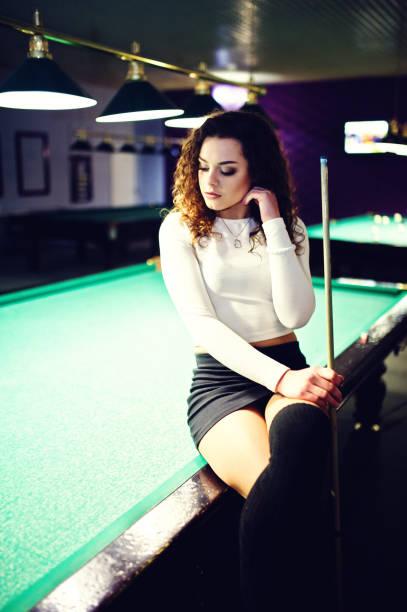 sexy women shooting pool
