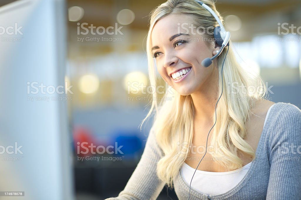 young customer service representative in a call centre stock photo