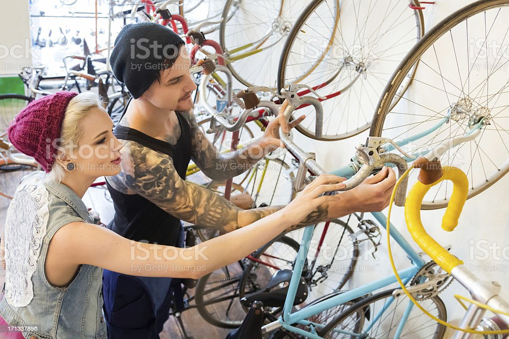 Young customers in a bike store stock photo