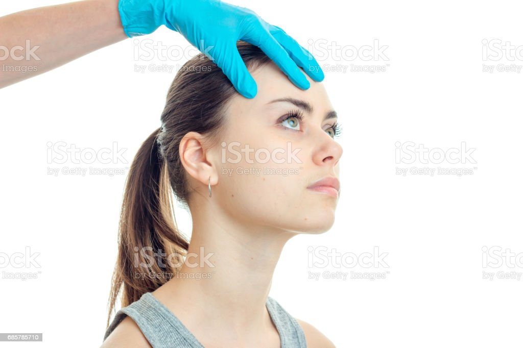 young cute girl with a tail at kosmetologist in blue gloves close-up foto de stock libre de derechos