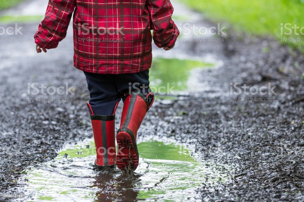 Young Cute Kid Walking Jumping into Water Puddle - Royalty-free 2-3 Years Stock Photo