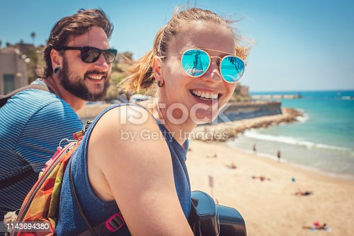 Man and woman reaching sea while travelling Middle East