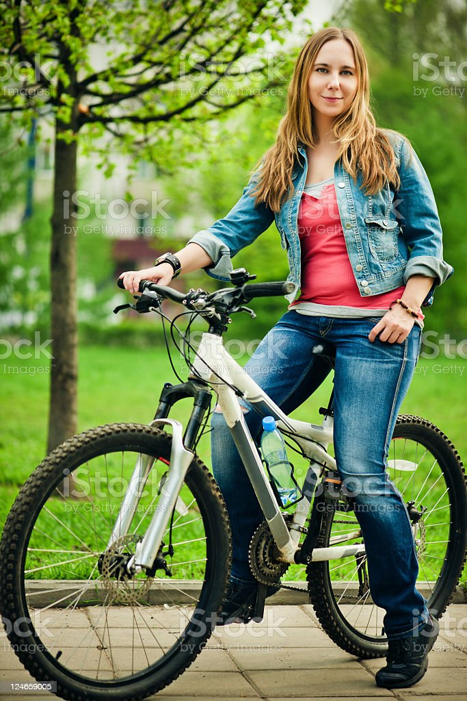 Young cyclist in a park royalty-free stock photo