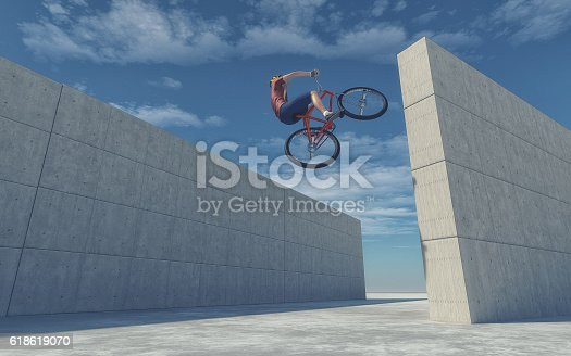istock Young cyclist jumping 618619070
