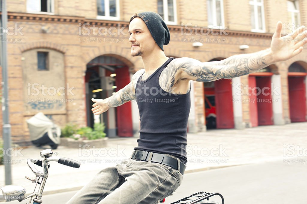 Young cyclist with tattoos in Berlin stock photo