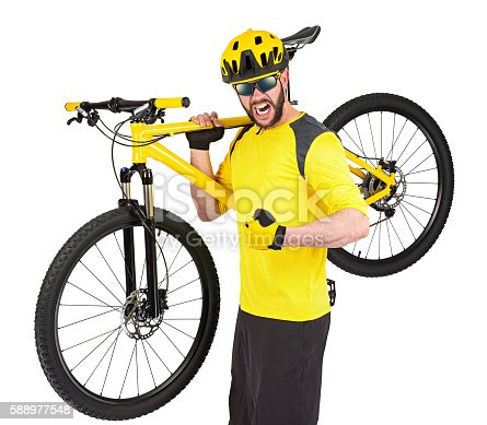 istock young cyclist with yellow mountain bike 588977548