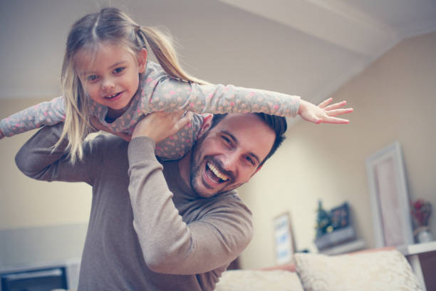 young dad with cute daughter at home. - father and daughter stock photos and pictures