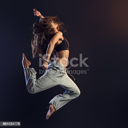 istock Young dancer performing 864434178