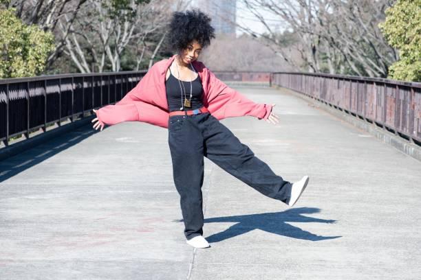 young dancer practicing outside - showus стоковые фото и изображения