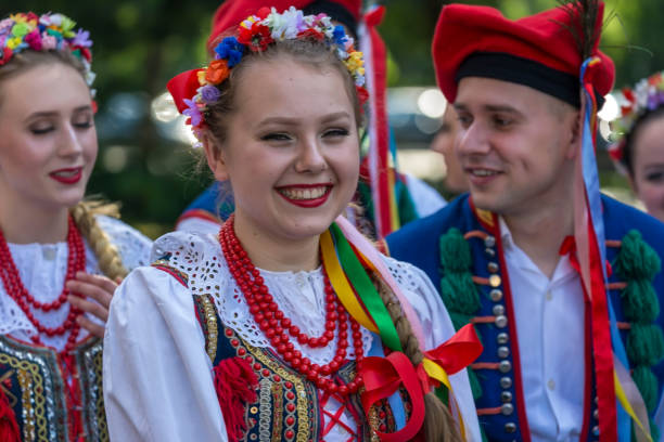 "Young dancers from Poland in traditional costume Timisoara: Young dancers from Poland in traditional costume present at the international folk festival ""International Festival of hearts"" organized by the City Hall Timisoara. polish culture stock pictures, royalty-free photos & images"