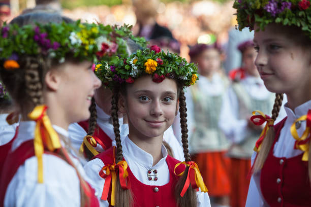 Young dancers Riga, Latvia - July 12, 2015: The Latvian National Song and Dance Festival Grand Finale concert. Young dancers can be seen smiling and posing at the camera. latvia stock pictures, royalty-free photos & images