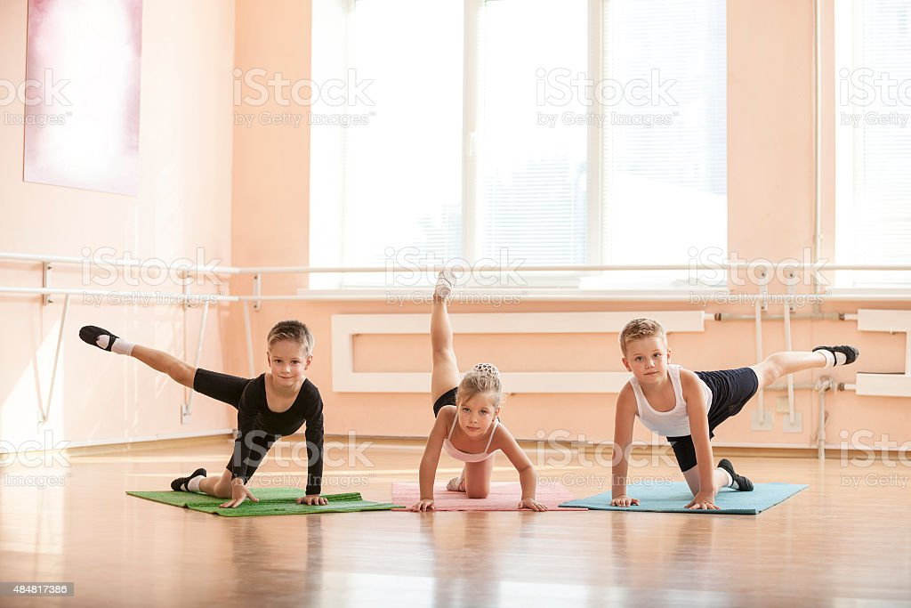 Young dancers warming up at ballet class stock photo