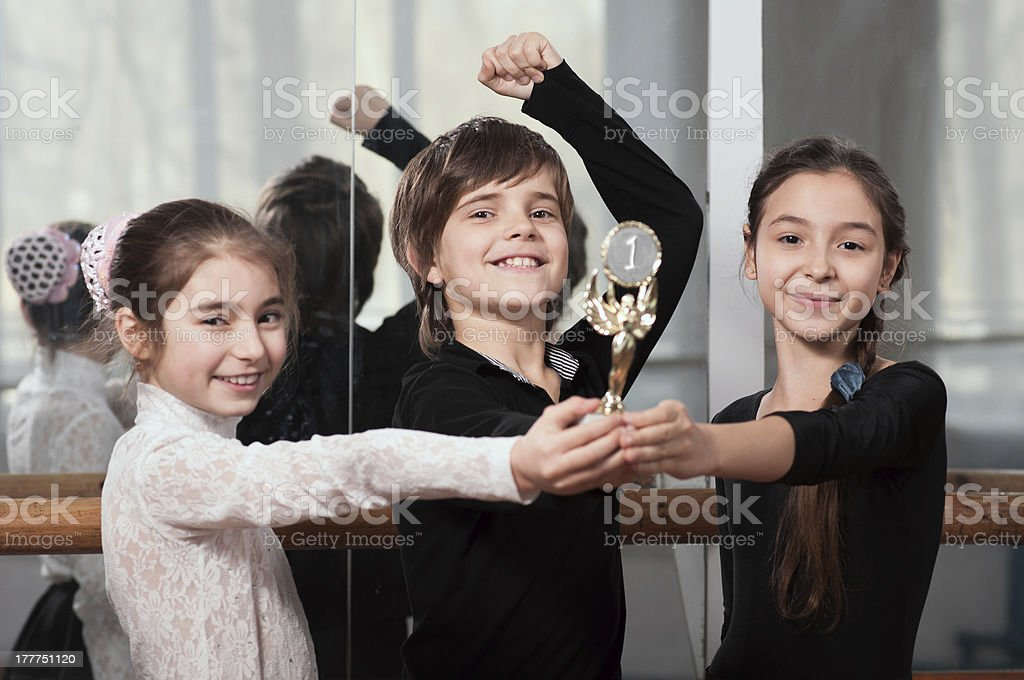 young dancers won the cup stock photo