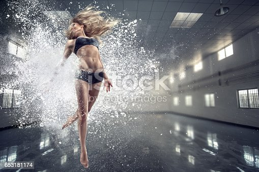 461209029 istock photo Young dancing woman 653181174