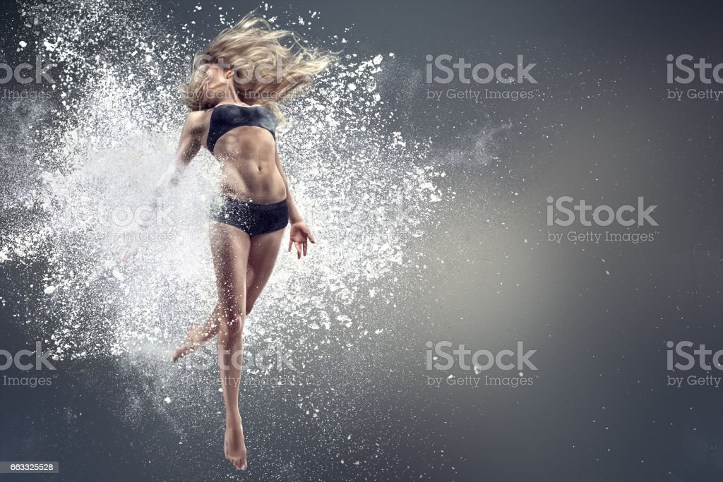 Young dancing woman stock photo