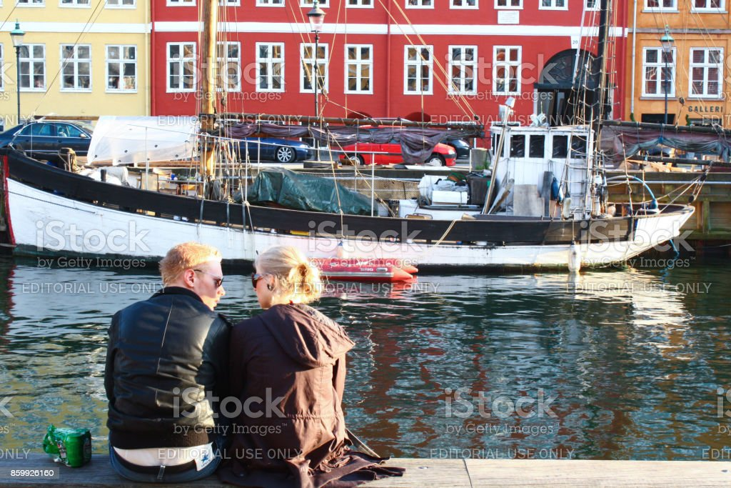 Young Danish couple by Nyhavn Canal stock photo