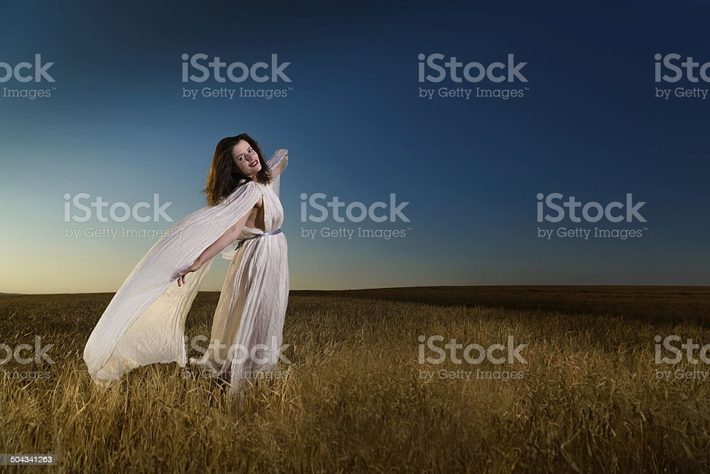 Young dark hair woman in field stock photo