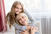 istock Young daughter cuddling her senior mother with love 1133797401