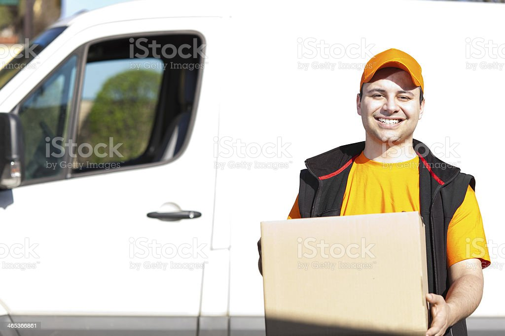 Young delivery man portrait stock photo