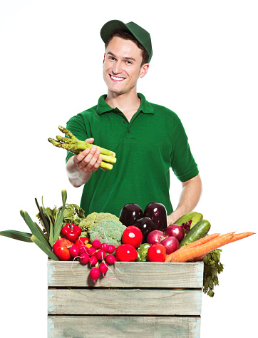 Young Delivery Man With Organic Food Stock Photo - Download Image Now
