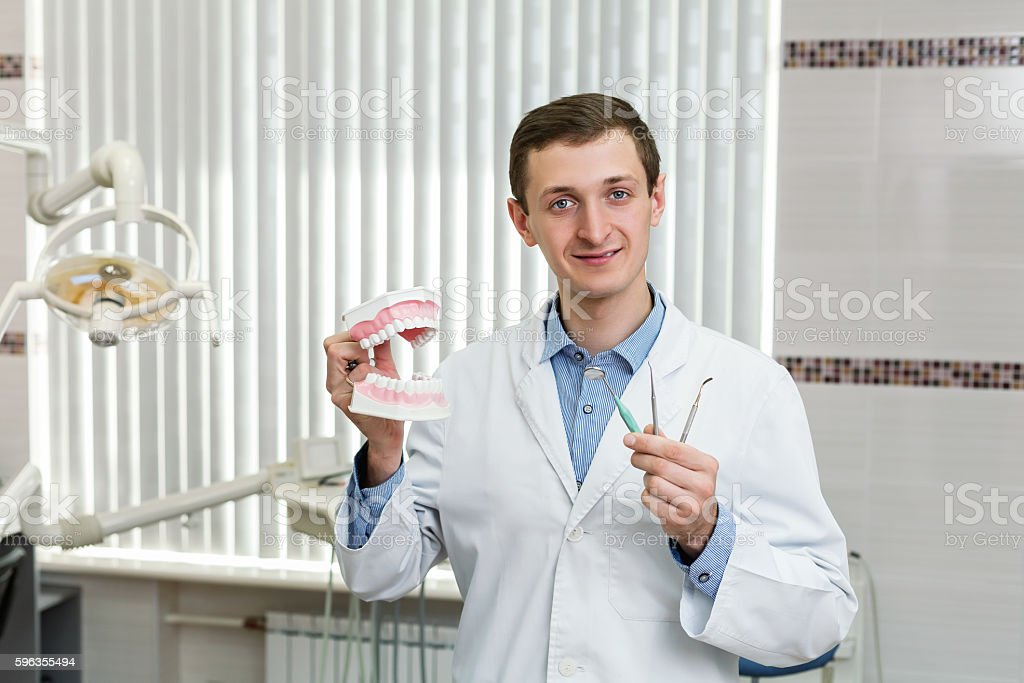 Young dentist in the office royalty-free stock photo