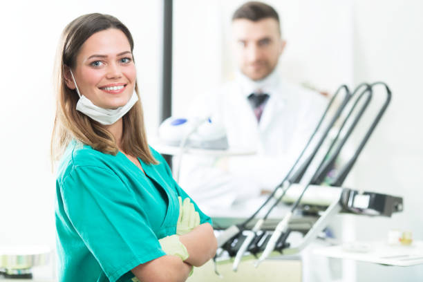 young dentist posing - dental assistant stock photos and pictures