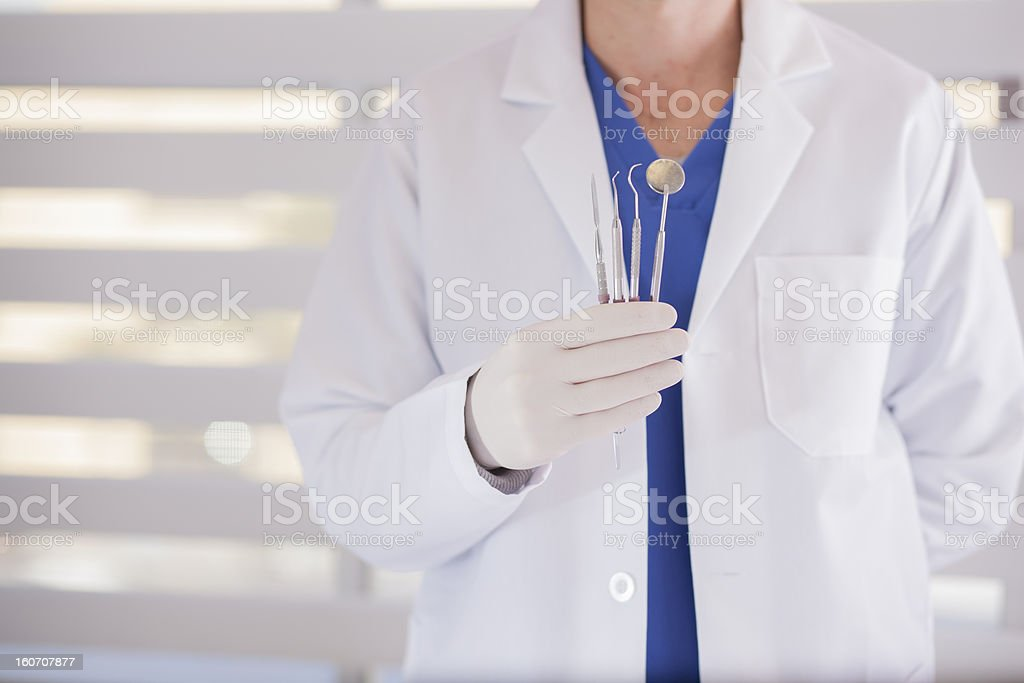 Young dentist showing his instruments royalty-free stock photo