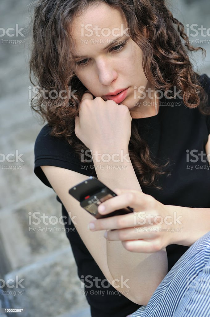 Young depressed reading bad message on phone royalty-free stock photo