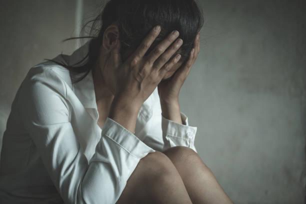 Young depressed woman stock photo