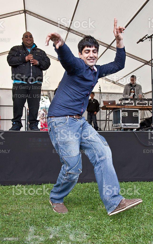 Young desi man dancing in Bhangra style; Edinburgh Mela stock photo
