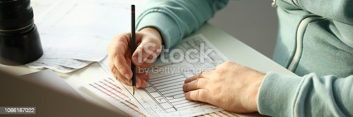 istock A young designer holds a pen from a tablet in his 1066167022