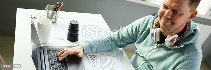 istock A young designer holds a pen from a tablet in his 1066167064
