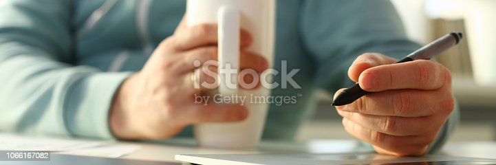 istock A young designer holds a pen from a tablet in his 1066167082