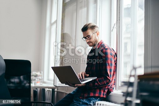 istock Young designer working from home office 617766704