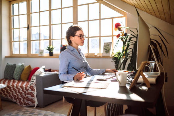 Young designer working from home stock photo