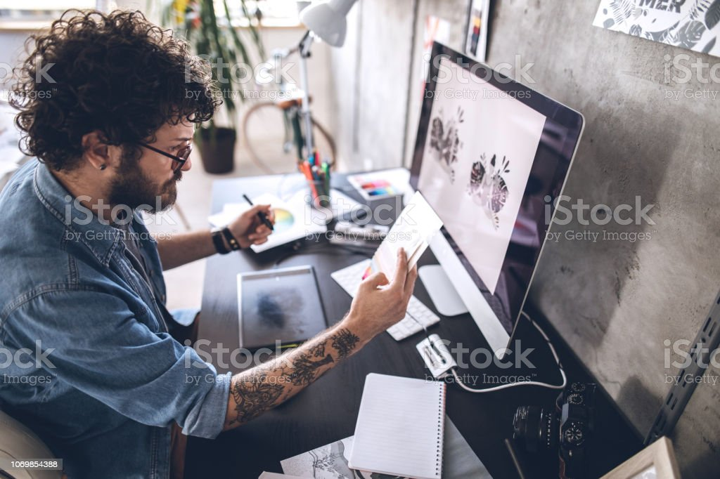 Young designer working on new project Handsome Young Man Working In Comfort of His Home 25-29 Years Stock Photo