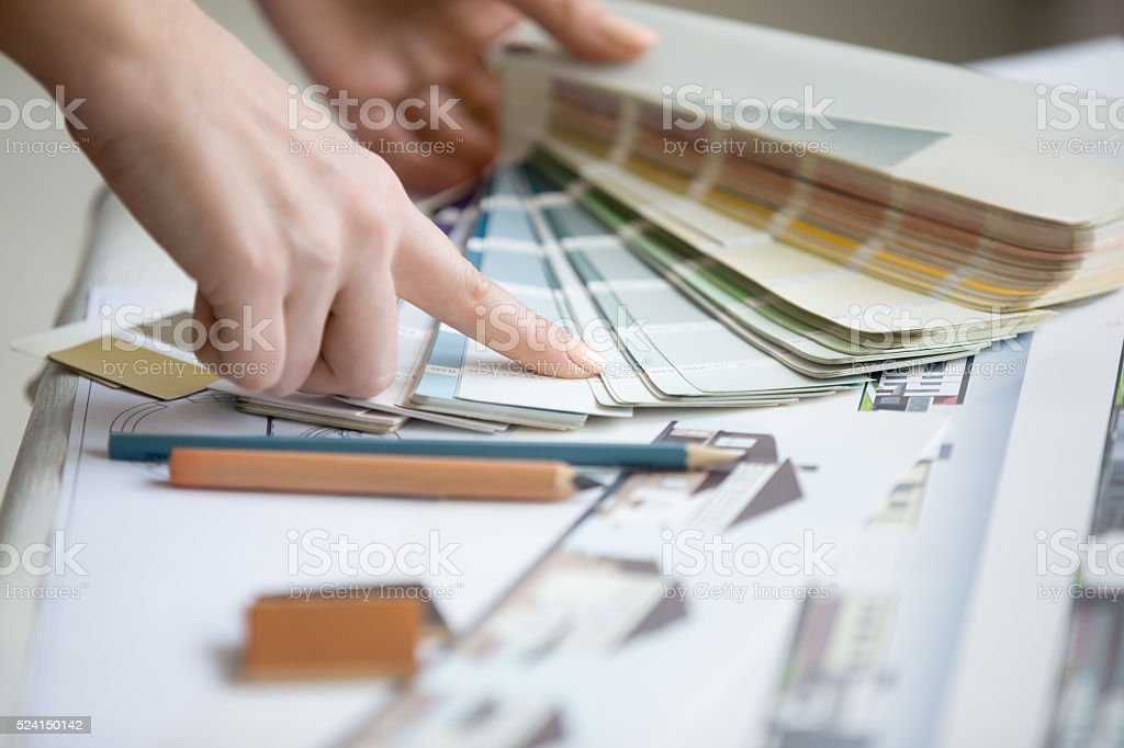 Young designer working with color palette stock photo