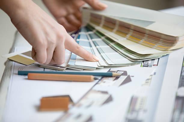 young designer working with color palette - interior design stockfoto's en -beelden