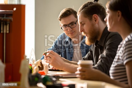 886646936 istock photo Young Designers Collaborating on 3D Project 886646916