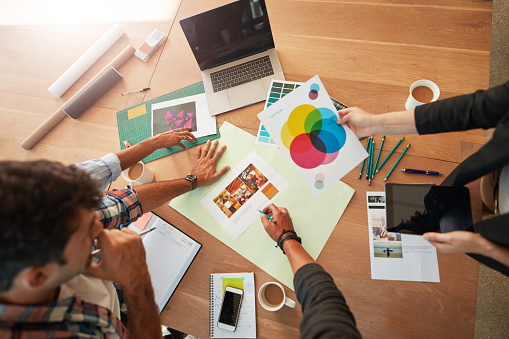 Young Designers Discussing The Color Palette Stock Photo - Download Image Now