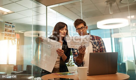 842214626istockphoto Young designers working together on a creative project 842214436