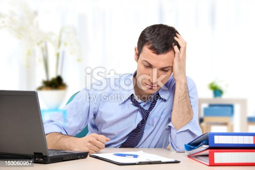 istock Young desperate businessman in his office 153060957