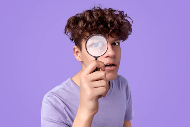 Young detective looking at camera stock photo