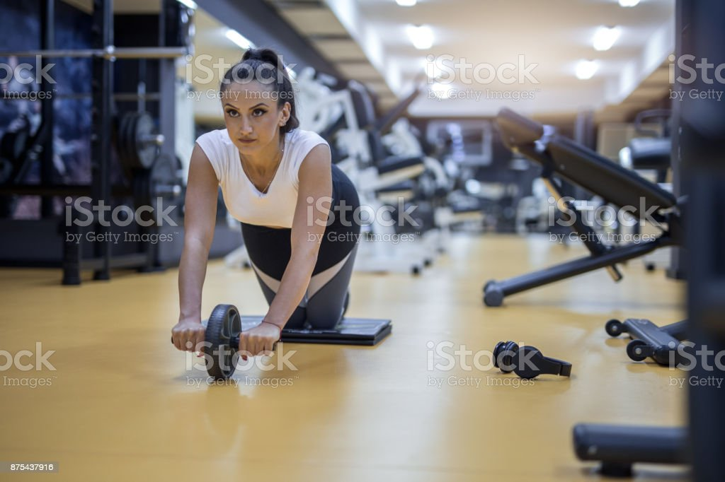 Young determined woman training at gym stock photo