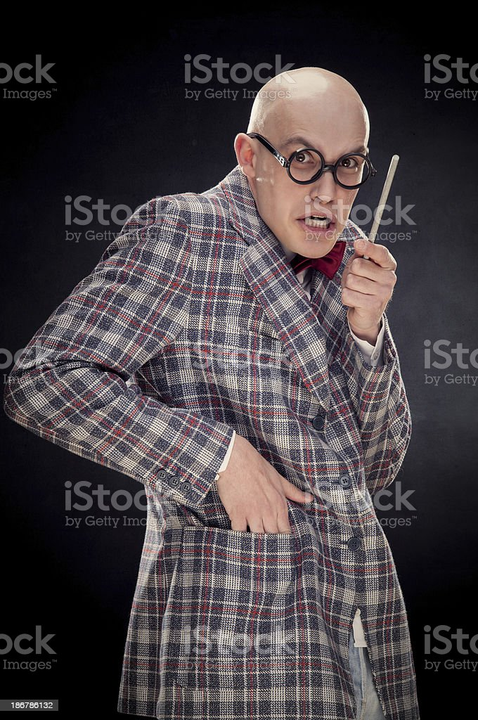 Young diabolic bald professor with red bow tie black isolated royalty-free stock photo