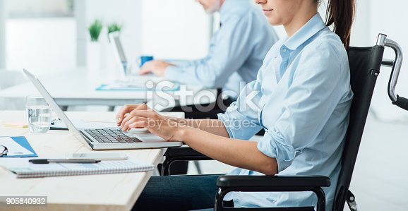 1144373653 istock photo Young disabled businesswoman at work 905840932
