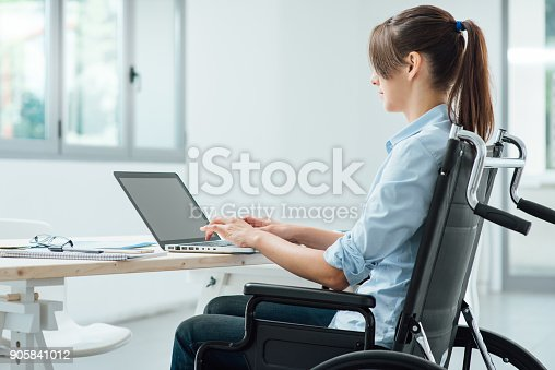 1144373653 istock photo Young disabled businesswoman at work 905841012